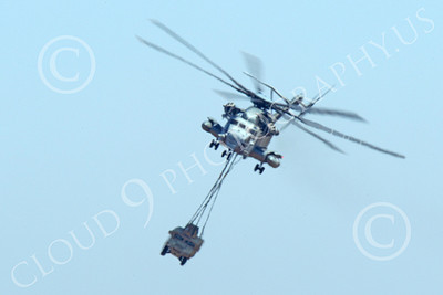 CH-53EUSMC 00052 Frontal view of a USMC Sikorsky CH-53E Super Stallion with a slinged military vehicle load, military helicopter picture, by Peter J Mancus