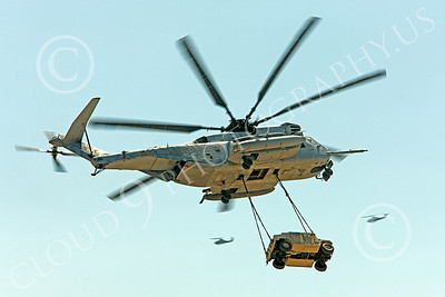 CH-53EUSMC 00008 A flying USMC Sikorsky CH-53E Super Stallion with a slinged load and USMC Cobra gunship helos in the background, military helicopter picture, by Peter J Mancus