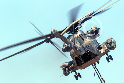 CH-53EUSMC 00060 Quarter rear view of a flying USMC Sikorsky CH-53E Super Stallion with a slinged load, military helicopter picture, by Peter J Mancus
