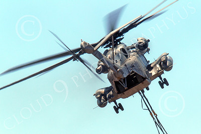 CH-53EUSMC 00010 Quarter rear view of a flying USMC Sikorsky CH-53E Super Stallion with a slinged load, military helicopter picture, by Peter J Mancus