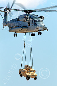 CH-53EUSMC 00001 A USMC Sikorsky CH-53E Super Stallion airlifts a military vehicle, helicopter picture, by Peter J Mancus