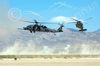 H-60USAF 00072 An awesome, dynamic, action scene of two flying Sikorsky HH-60 Pave Hawks USAF helicopter picture 8-2005 by Peter J Mancus