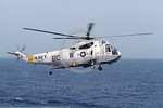 SH-3USN-HS-17 002 A flying Sikorsky SH-3H Sea King USN anti-submarine warfare helicopter 148052 HS-17 NEPTUNE RAIDERS USS Coral Sea 5-1986 military helicopter picture by Michael Grove, Sr    ...