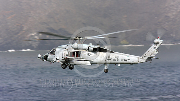 HM - SH-60USN 00024 A US Navy Sikorsky SH-60 Seahawk HS-15 seen flying over a body of water and a coastline, by Peter J Mancus