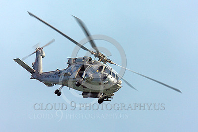 HM - SH-60USN 00008 Quarter front view of a flying US Navy Sikorsky SH-60 Seahawk assigned to HS-15, by Peter J Mancus
