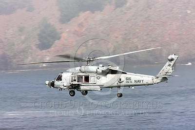 HM - SH-60USN 00030 A US Navy Sikorsky SH-60 Seahawk HS-15 seen flying over a body of water and near a coastline, military helicopter picture, by Peter J Mancus