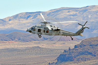 MH-60-USN 0012 A low flying low visibility gray color scheme Sikorsky MH-60S Seahawk USN multi-mission helicopter NAWDC banks to land at NAS Fallon 3-2017 military helicopter picture by Peter J Mancus     DONEwt