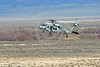 MH-60-USN 0014 A low flying low visibility gray color scheme Sikorsky MH-60S Seahawk USN multi-mission helicopter NAWDC prepares to land at NAS Fallon 3-2017 military helicopter picture by Peter J Mancus     DONEwt