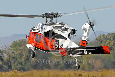 HM - SH-60USN 00040 A colorful US Navy Sikorsky SH-60 Seahawk SAR Search and Rescue helicopter hoovers at NAS Fallon, miliary helicopter picture, by Peter J Mancus