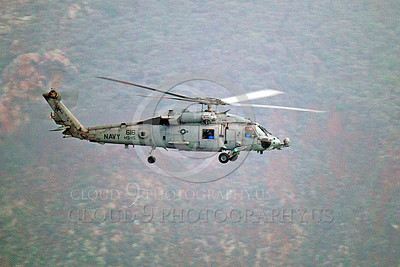 HM - SH-60USN 00026 A US Navy Sikorsky SH-60 Seahawk HS-15 seen flying along side a rocky cliff, by Peter J Mancus