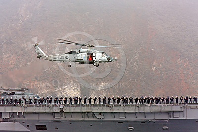 HM - SH-60USN 00014 A US Navy Sikorsky SH-60 Seahawk HS-15 seen flying over a US Navy warship, by Peter J Mancus