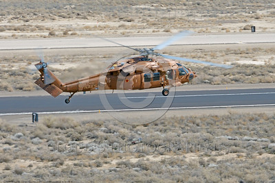 MH-60-USN 0010 A Sikorsky MH-60S Seahawk USN multi-mission helicopter NAWDC flies and banks right at NAS Fallon 3-2017 military helicopter picture by Peter J Mancus     DONEwt