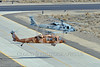 MH-60-USN 0006 Two Sikorsky MH-60S Seahawks USN multi-mission helicopters take off in unison at NAS Fallon 3-2017 military helicopter picture by Peter J Mancus     DONEwt