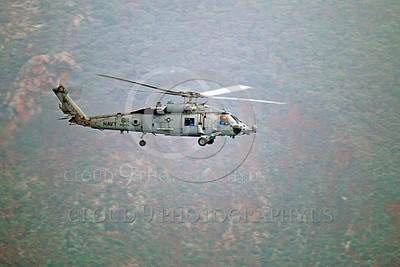 HM - SH-60USN 00012 A US Navy Sikorsky SH-60 Seahawk HS-15 seen flying along side a rocky cliff, by Peter J Mancus