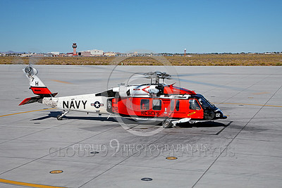 HM - SH-60USN 00021 A colorful US Navy Sikorsky SH-60 Seahawk SAR Search and Rescue helicopter during engine run-up at NAS Fallon, miliary helicopter picture, by Peter J Mancus