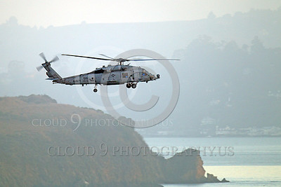 HM - SH-60USN 00006 A US Navy Sikorsky SH-60 Seahawk HS-15 seen flying along a coast line, by Peter J Mancus