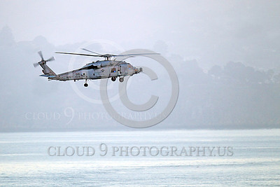 HM - SH-60USN 00034 A US Navy Sikorsky SH-60 Seahawk HS-15 seen flying over a body of water and a coastline, military helicopter picture, by Peter J Mancus