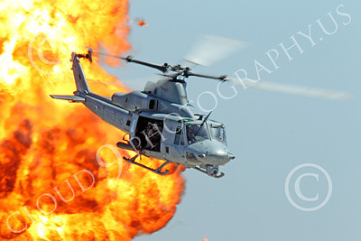 UH-1Y USMC 00004 A USMC Bell UH-1Y Huey Venom seen flying pass a large fiery explosion, military helicopter picture, by Peter J Mancus