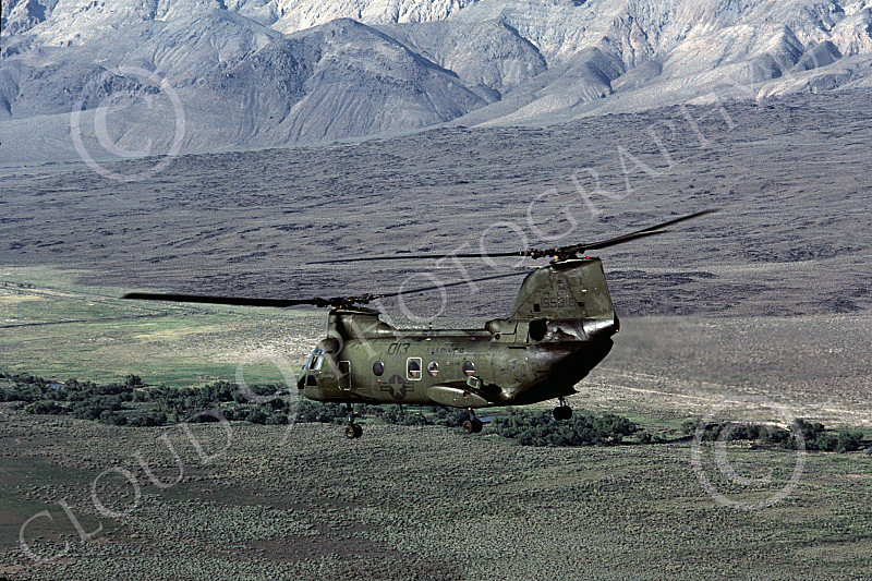 CH-46USMC 00023 A USMC Boeing CH-46 Sea Knights flying over land, 6-1985, by Peter J Mancus