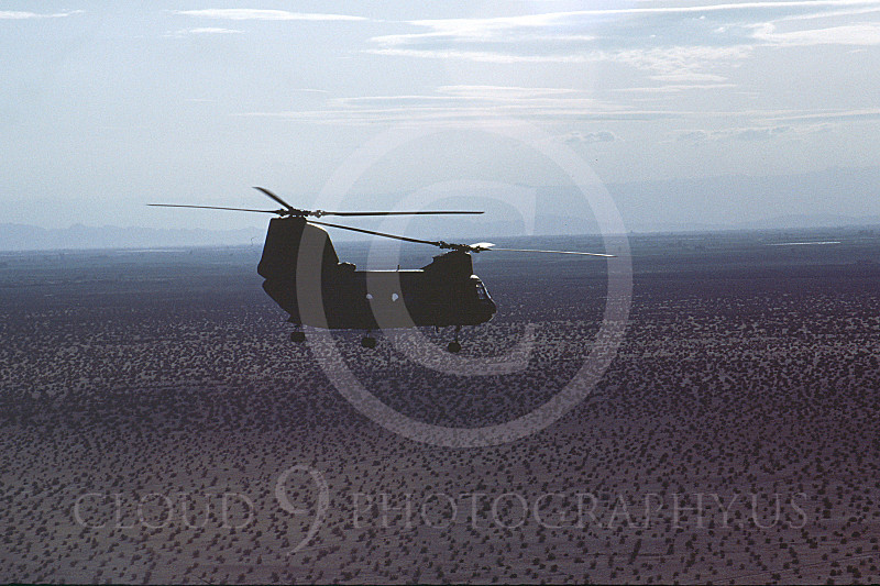 CH-46USMC 00019 A lone USMC Boeing CH-46 Sea Knight flying over flat desert, 6-1985, by Peter J Mancus