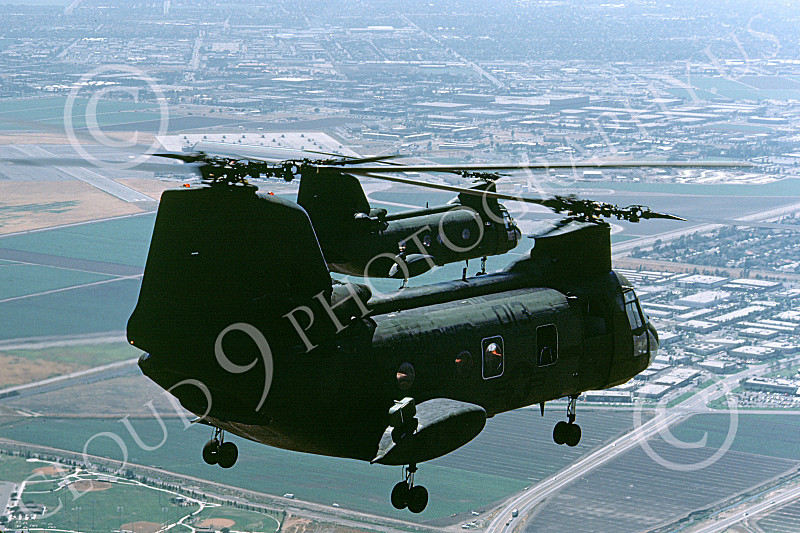 CH-46USMC 00029 Two USMC Boeing CH-46 Sea Knights approach MCAS Tustin, 6-1985, by Peter J Mancus