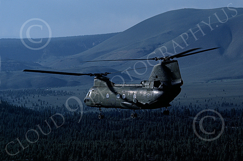 CH-46USMC 00038 A USMC Boeing CH-46 Sea Knight flys over forested land, 6-1985, by Peter J Mancus