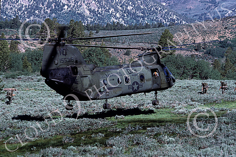 CH-46USMC 00006 A USMC Boeing CH-46 Sea Knight lifting off at Camp Pendelton, 6-1985, by Peter J Mancus