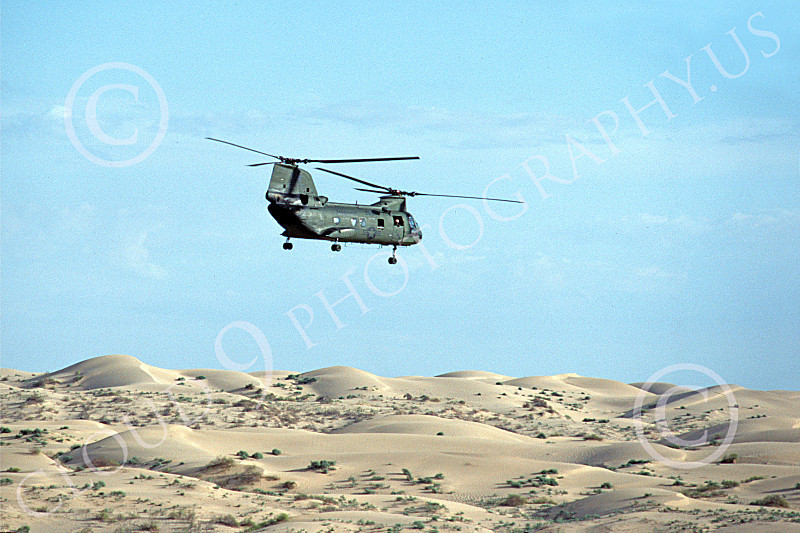 CH-46USMC 00009 A USMC Boeing CH-46 Sea Knight flying over sand dunes, 11-1983, by Peter J Mancus
