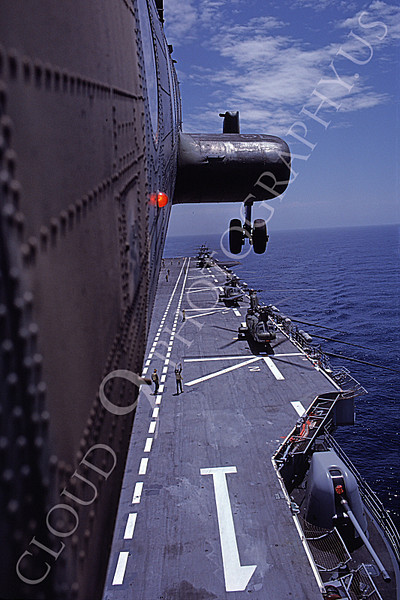 CH-46USMC 00026 A USMC Boeing CH-46 Sea Knight above the USS Tarawa LHA-1, 6-1985, by Peter J Mancus