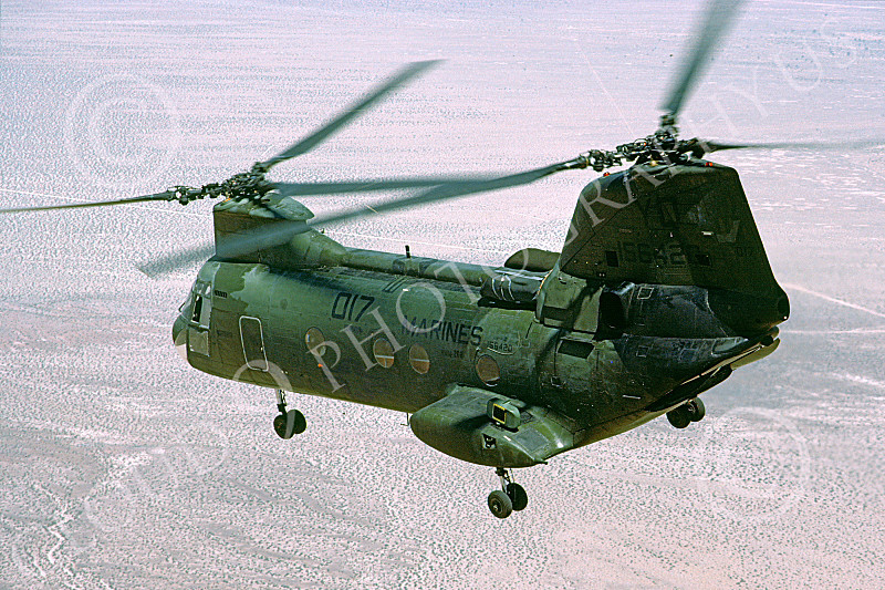 CH-46USMC 00015 A USMC Boeing CH-46 Sea Knight flying over desert terrain banks left, 6-1985, by Peter J Mancus
