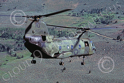 CH-46USMC 00014 A USMC Boeing CH-46 Sea Knight flying over sage brush high country terrain, 6-1985, by Peter J Mancus