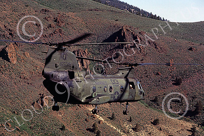 CH-46USMC 00028 A USMC Boeing CH-46 Sea Knight flys close to a mountain slope, 6-1985, by Peter J Mancus