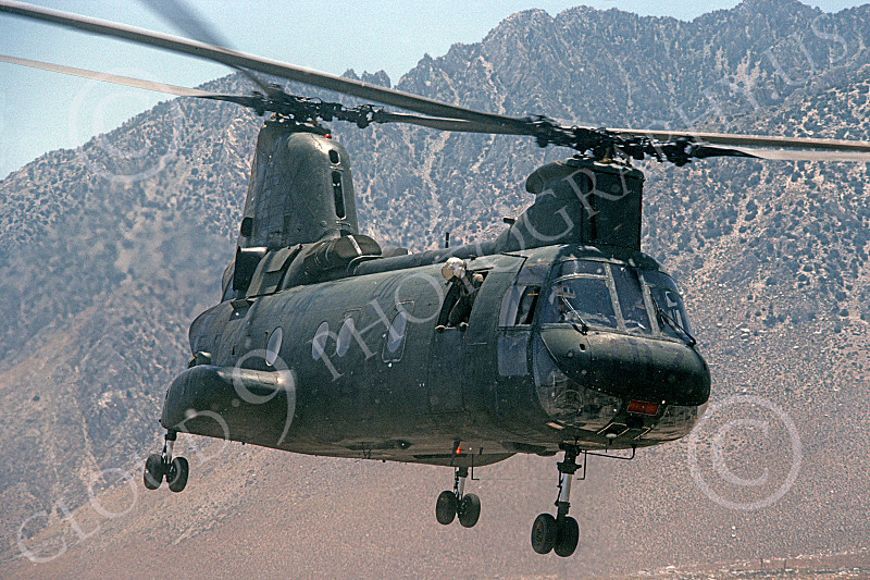 CH-46USMC 00027 A USMC Boeing CH-46 Sea Knight lifts off from barren land, 6-1985, by Peter J Mancus