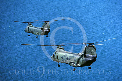 CH-46USMC 00016 Two USMC Boeing CH-46 Sea Knights fly in formation over the ocean, 6-1985, by Peter J Mancus