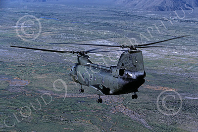 CH-46USMC 00025 A USMC Boeing CH-46 Sea Knight flying over barren land, 6-1985, by Peter J Mancus