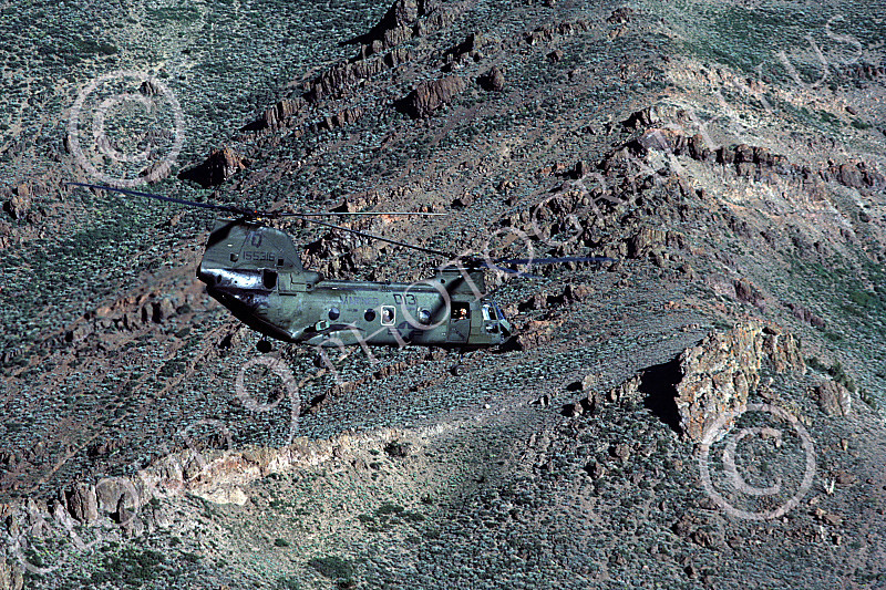 CH-46USMC 00005 A USMC Boeing CH-46 Sea Knight flying over rugged terrain, 6-1985, by Peter J Mancus  ppphfd