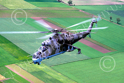 Mi-24 00006 A flying Mil Mi-24D Hind attack helicopter Polish Air Force 6-2003 by Jessie Collins