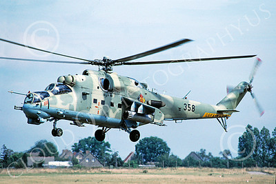 Mi-24 00008 A flying Mil Mi-24D Hind attack helicopter East German Air Force 8-1990 by Wilfried Zetsche