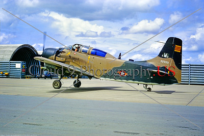 A-1Forg-SoVN 001 A South Vietnamese Air Froce Douglas A-1E Skyraider 32559 with live bombs taxis at an air base in South Vietnam in 1969 during the Vietnam War, via S  Wolf coll   DONEwt copy