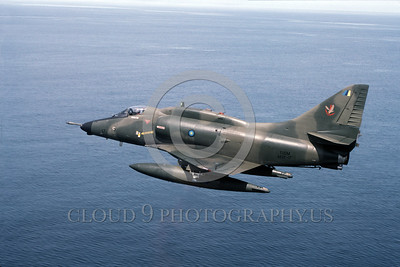 A-4Forg-Braz 0002 A Brazilian Navy Douglas A-4 Skyhawk attack jet TUDM M32-17 flying over water military airplane picture via African Aviation Slide Service