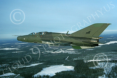 Mikoyan-Guryevich MiG-21U Mongol 00004 An in-flight green Finnish Air Force Mikoyan-Guryevich MiG-21U Mongol jet fighter trainer, 2-1997, by Karl Siemen