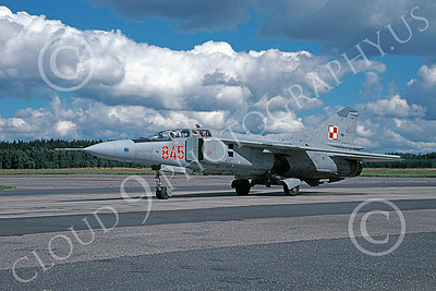 MiG-23UB 00017 A taxing MiG-23UB Flogger Polish Air Force 845 9-1999 military airplane picture with beautiful clouds by Patrick Naber
