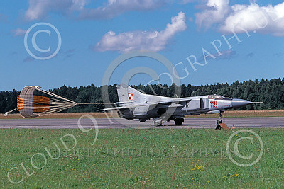 MiG-23 00075 A taxing MiG-23 Flogger Polish Air Force 115 9-1999 with chute deployed military airplane picture by Erick Briggs