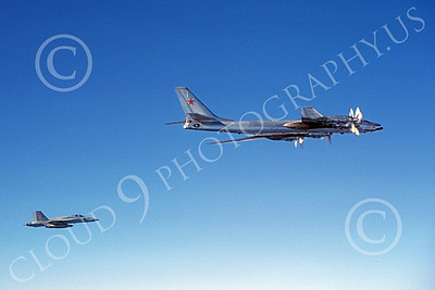 Tu-95 00016 A flying Tupolev Tu-95 Bear Soviet Air Force strategic bomber escorted by a USN F-18 jet fighter 8-1985 military airplane picture by Rick Morgan