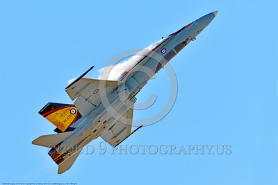 EE-F-18Forg 0038 A flying colorful McDonnell Douglas CF-18 Hornet jet fighter Canadian Armed Forces 188761 410 Sqd COUGARS with vortex 9-2016 military airplane picture by Peter J  Mancus