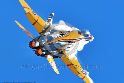 EE-F-18Forg 0040 A flying colorful McDonnell Douglas CF-18 Hornet jet fighter Canadian Armed Forces 188761 410 Sqd COURGARS in afterburner with vortex 9-2016 military airplane picture by Peter J  Mancus