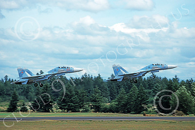 SU-27 00008 Two flying Sukhoi Su-27 Flankers Soviet Air Force 7-1992 military airplane picture by Renalto E F Jones