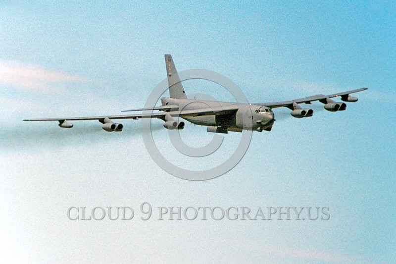 B-52 0078 Urban renewal on the wing--a flying Boeing B-52 Stratofortress USAF jet bomber on a bomb run with open bomb bay doors military airplane picture by Peter B Lewis