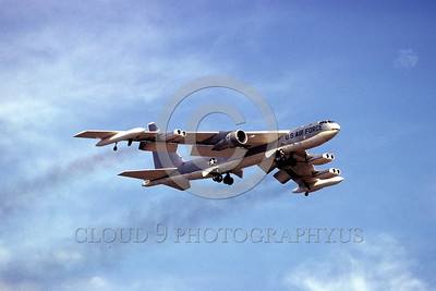 B-52 0018 A flying Boeing B-52 Stratofortress with large test engine 1977 military airplane picture by Ron McNeil