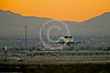 E-3USAF 00200 A Boeing E-3 Sentry USAF AWACS aircraft takes off at twilight at Nellis AFB during a Red Flag training exercise with B-2 Spirit stealth bombers taxing in the background military airplane picture by Peter J Mancus